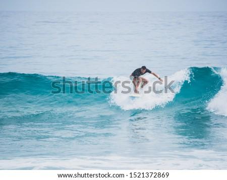 Surfer on top of the wave. Atlantic Ocean. #1521372869