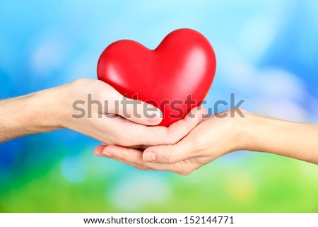Hearts in hands on nature background #152144771