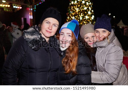 Moscow, December 31, 2017, four girlfriends are photographed near the New Year tree #1521495980