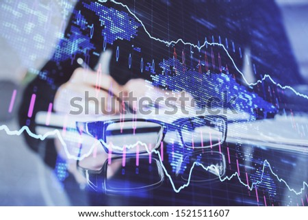 Forex chart hologram on hand taking notes background. Concept of analysis. Double exposure #1521511607