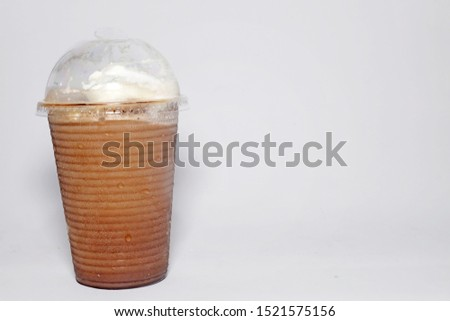 A picture of ice blended mocha on isolated white background with copyspace. #1521575156