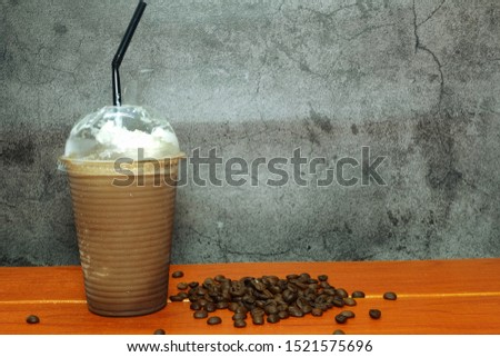A picture of ice blended mocha on the table with coffee beans. #1521575696