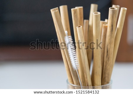 Nature drinking straws from bamboo wood for reusable and reduce the use of plastic straw. Reduce plastic waste in environment. Royalty-Free Stock Photo #1521584132
