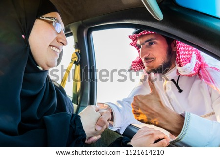 Muslim mother and her son at the car window #1521614210