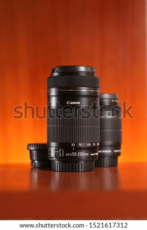 Iloilo City / Philippines - November 29, 2015: The Canon zoom lens 55 to 250 mm is a powerful gear for APS-C cameras. #1521617312