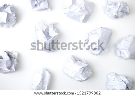 Flat lay of crumpled paper ball on white background. Top view. #1521799802