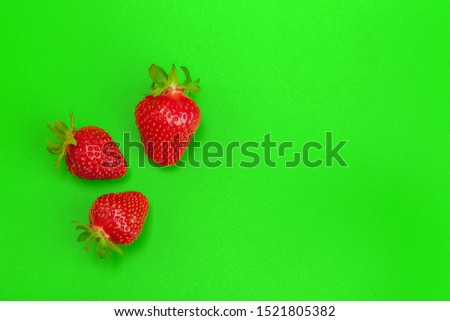 Ripe strawberries on bright green background. Healthy eating #1521805382