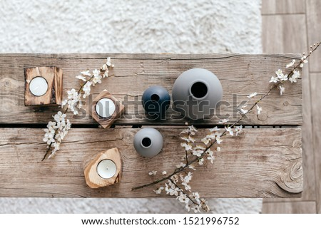 Spring home decor on reclaimed rustic bench, top view of scandinavian interior details. Royalty-Free Stock Photo #1521996752