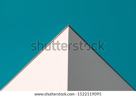 Modern Architecture Geometry against clear, blue sky. Minimalist Aesthetic. Abstract background with pyramidal shape. High Resolution Photography.