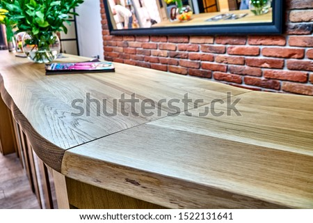 Wooden live edge table in solid oak. Solid oak countertop. Live edge counter top. Details furniture. Solid oak reception #1522131641