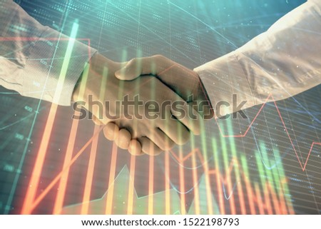 Multi exposure of forex graph on abstract background with two businessmen handshake. Concept of success on stock market #1522198793