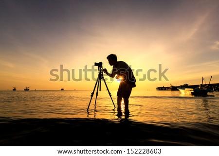 The Photographer takes a good shot on the Huahin beach, Thailand