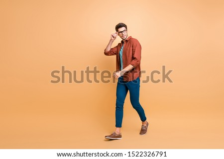 Full length body size profile side view of his he nice attractive trendy calm brunette guy business assistant shark expert touching specs walking isolated over beige color pastel background #1522326791