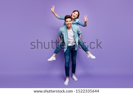 Full size photo of romantic couple with brunet hair redhair enjoy date honeymoon hug piggyback make v-signs wear trendy stylish outfit isolated over violet color background #1522335644