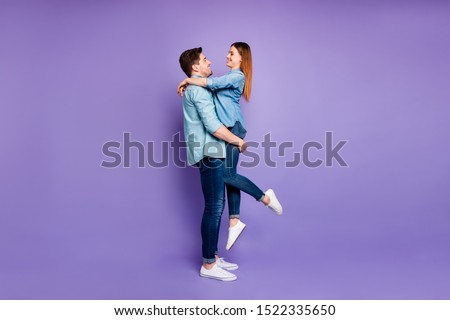Fulll length profile side photo of romantic couple of sweethearts hug hold  girl have romance date honeymoon wear stylish outfit white sneakers isolated over violet purple color background #1522335650