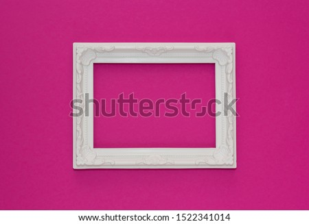 Abstract pink paper minimal background with white frame. Minimal composition with empty picture frame.