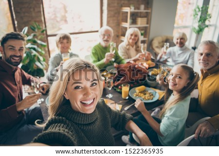 Photo of big family sit feast dishes table around roasted turkey multi-generation relatives making group selfies raising wine glasses juice in living room indoors #1522365935