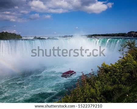 Cruise ship with tourists aboard looking at the Horseshoe Falls. Horseshoe Falls,  Niagara Falls. #1522379210