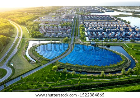 Modern sustainable neighbourhood in Almere, The Netherlands. The city heating (stadswarmte) in the district is partially powered by a solar panel island (Zoneiland). Aerial view. #1522384865