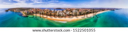 180 degrees panorama against Manly beach on Sydney Pacific coast from North Head to Northern beaches - elevated aerial view towards Sydney Harbour and city CBD. Royalty-Free Stock Photo #1522501055