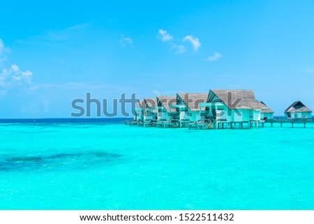 Beautiful tropical Maldives resort hotel and island with beach and sea  - boost up color processing style #1522511432