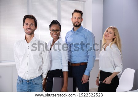 Portrait Of Confident Smiling Successful Business People Standing In Office Looking At Camera #1522522523