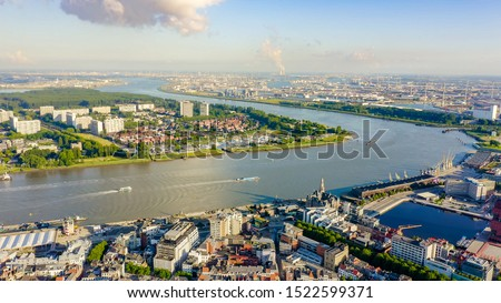 Antwerp, Belgium. Flying over the roofs of the historic city. Schelde (Esco) river. Industrial area of the city, Aerial View   #1522599371