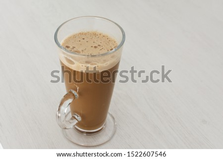Long glass cup of cappuccino on coffe latte. #1522607546