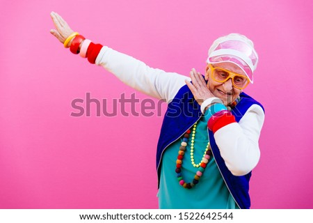 Funny grandmother portraits. 80s style outfit. Dab dance on colored backgrounds. Concept about seniority and old people #1522642544