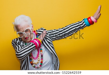 Funny grandmother portraits. Senior old woman dressing elegant for a special event. granny fashion model on colored backgrounds #1522642559
