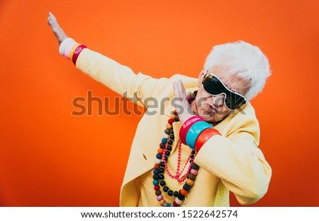 Funny grandmother portraits. Senior old woman dressing elegant for a special event. granny fashion model on colored backgrounds Royalty-Free Stock Photo #1522642574