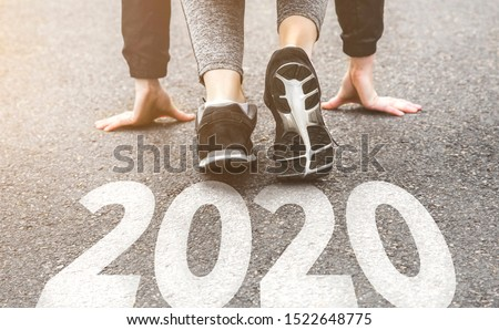 Woman in sports uniform running around. Healthy way of life, an infused figure. sneakers close-up, finish 2019 Start to new year 2020, plans, goals, objectives #1522648775