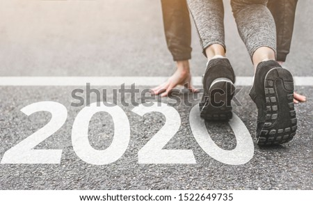 Woman in sports uniform running around. Healthy way of life, an infused figure. sneakers close-up, finish 2019 Start to new year 2020, plans, goals, objectives #1522649735