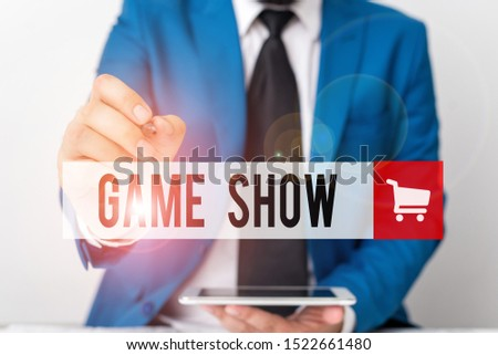 Word writing text Game Show. Business concept for Program in television or radio with players that win prizes Businessman pointing with pen in empty copy space. #1522661480