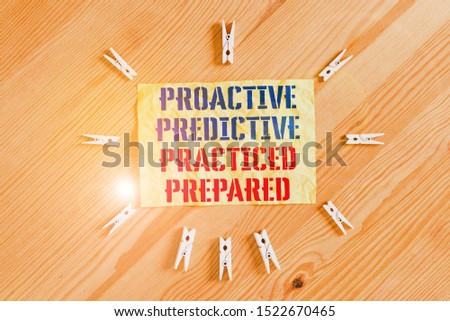 Writing note showing Proactive Predictive Practiced Prepared. Business photo showcasing Preparation Strategies Management Colored clothespin papers empty reminder wooden floor background office. #1522670465