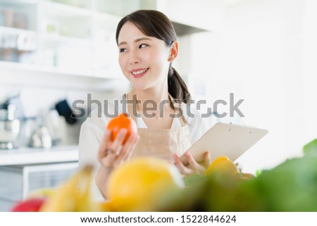 Young asian woman and vegetables. Food coordinator. Nutritionist. #1522844624