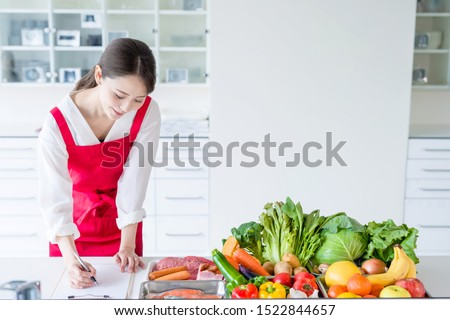 Young asian woman and vegetables. Food coordinator. Nutritionist. #1522844657