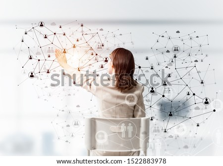 HR specialist managing abstract social network structure. Back view long haired woman in white suit sitting on white chair. Recruitment and resourcing. Global company human resources management. #1522883978