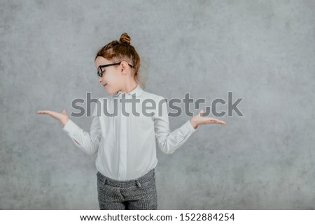 little businesswoman. little businesswoman on yellow background. business lady. little businesswoman with serious and confident look. formal fashion for little businesswoman #1522884254