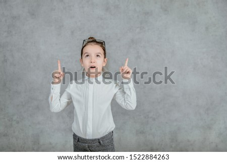 little businesswoman. little businesswoman on yellow background. business lady. little businesswoman with serious and confident look. formal fashion for little businesswoman.Looking up and puts your #1522884263