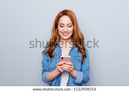 Close up photo beautiful she her lady arm hand telephone smart phone reader look see news check instagram followers stories pictures wear casual blue jeans denim shirt isolated grey background