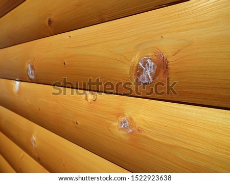 Patched holes from in a wood surface. Fixed wood house. Patch wood scars on a wooden house. #1522923638