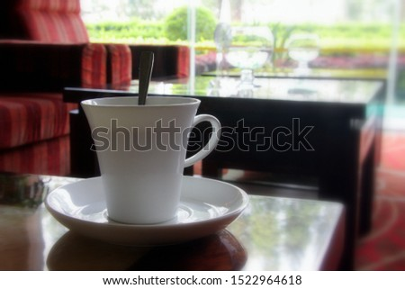 White cup of coffee. A cup of tea. Nice view from the window. Two small cups. China. #1522964618