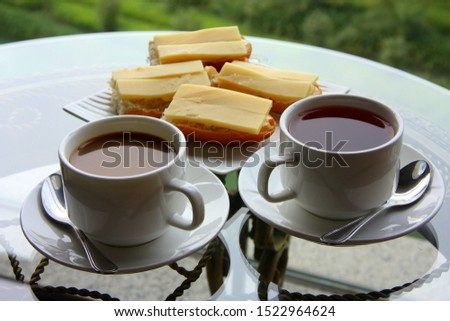 White cup of coffee. A cup of tea. Nice view from the window. Two small cups. China. #1522964624