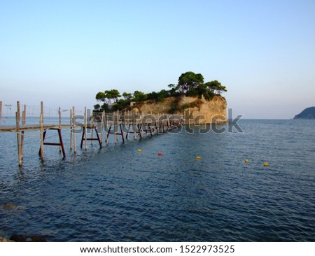 Wooden bridge leading to Cameo Island. Cameo Island is located very close to Laganas beach and is a desirable place to visit. Cameo Island or otherwise Agios Sostis beach. #1522973525