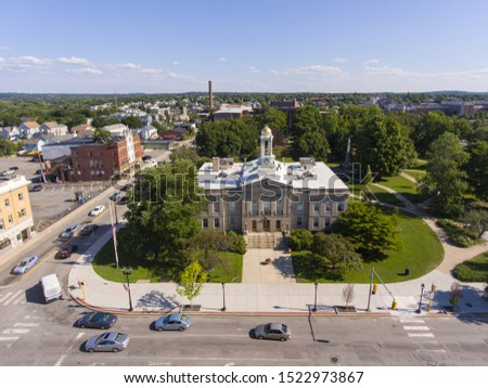 Waltham City Hall and downtown with Boston skyline at the background aerial view in downtown Waltham, Massachusetts, MA, USA.