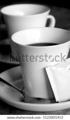 White cup of coffee. A cup of tea. Nice view from the window. Two small cups. China. #1523001413