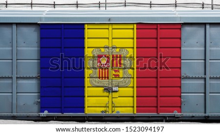 Front view of a container train freight car with a large metal lock with the national flag of Andorra.The concept of export-import,transportation, national delivery of goods and rail transportation #1523094197