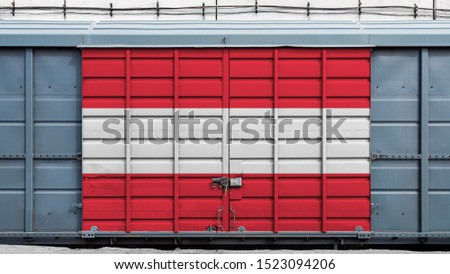 Front view of a container train freight car with a large metal lock with the national flag of Austria.The concept of export-import,transportation, national delivery of goods and rail transportation #1523094206