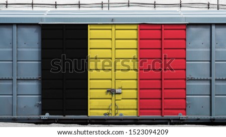 Front view of a container train freight car with a large metal lock with the national flag of Belgium.The concept of export-import,transportation, national delivery of goods and rail transportation #1523094209